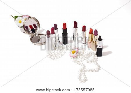 Lipstick isolated on white background. Female lip pencil. Kiss of lips on paper. The word love written in lipstick. Reflection of lipstick in the mirror. View from above. Concept. Decorative cosmetics