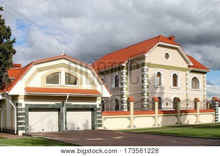 BORISOGLEBSK VORONEZH OBLAST RUSSIA- JULY 21 2015: Modern cottage and garage with a tiled roof in the town of Borisoglebsk Voronezh region. Russia.