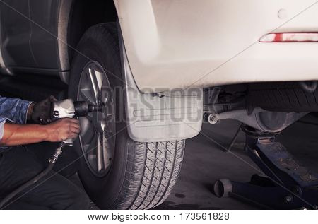 Air impact wrench for repairing wheel and suspension system.