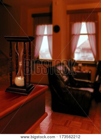 beautiful hourglass counting down the old house