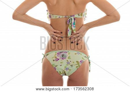 young girl with nice body in swimsuit worth turning your back to the camera and keeps his hands on the sides of isolated on white background.