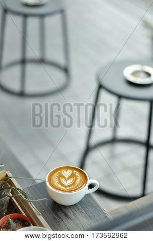 Coffee Cup With Latte Art On The Wood Table