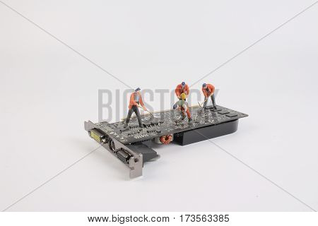 Engineers Repairing Circuit Mother Board