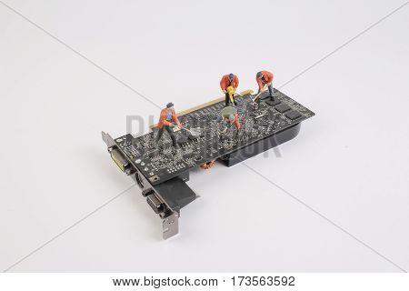 Engineers Repairing Circuit Mother Board