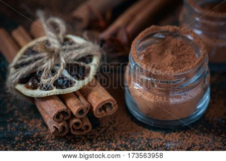 Cinnamon Sticks And  Powder Close Up On Wooden Background, Rustic Style