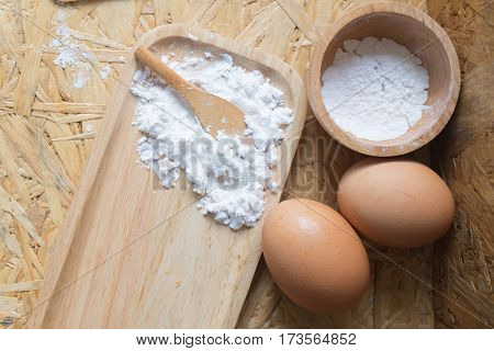 Baking background with flour and fresh eggs. Flat lay style.