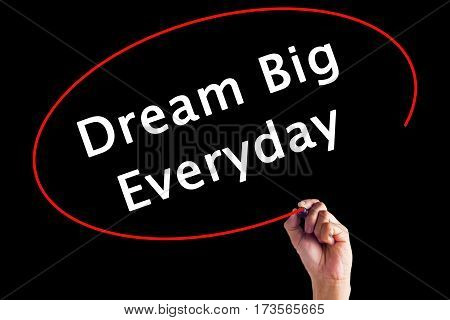Hand Writing Dream Big Everyday With A Marker Over Transparent Board.