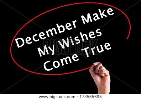 Hand Writing December Make My Wishes Come True With A Marker Over Transparent Board.