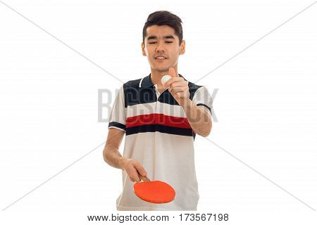 handsome brunette man practicing ping-pong isolated on white