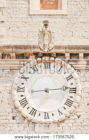Clockface of Sveti Ivan church clock in old Croatian town of Sibenik