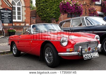AMERSHAM, UK - SEPTEMBER 13: A vintage MG convertible sportscar is parked on the side of the highway as a static display at the Amersham Heritage Day festival on September 13, 2015 in Amersham.