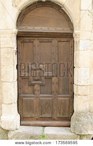 old wooden door of a house in Provence France