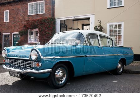 AMERSHAM, UK - SEPTEMBER 13: A vintage Vauxhall motorcar is parked on the side of the highway as a static display at the Amersham Heritage Day festival on September 13, 2015 in Amersham.