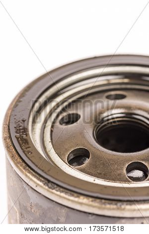 Macro Close Up Car Oil Filter Over White Background