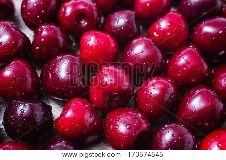 Background of ripe red cherries with water drops. Healthy eating. The texture of berries