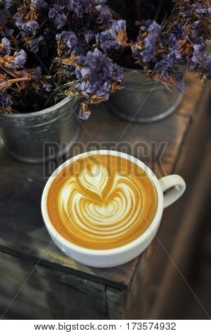 Coffee Cup With Latte Art On The Wooden Trunk