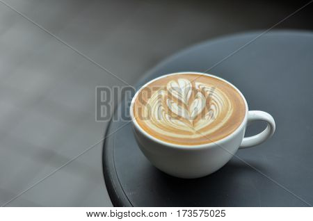 Coffee Cup With Latte Art On The Black Metal Table