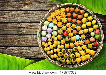 Dessert of Thailand Arranged in a wicker basket on the wooden floor with banana leaves.