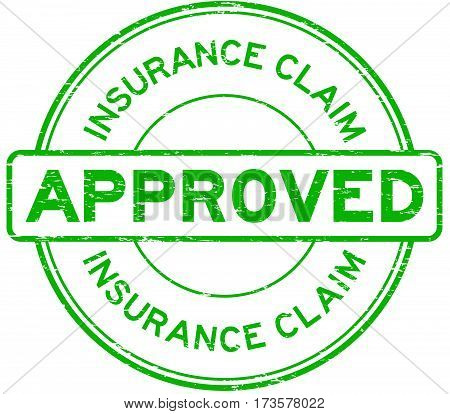 Grunge green insurance claim approved round rubber seal stamp