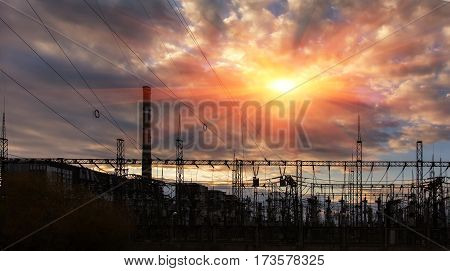 electricity distribution station at sunset. high voltage electric transmission tower.