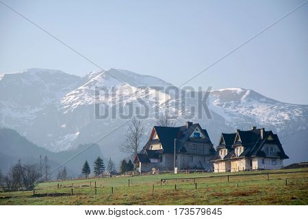Scenic View Of A Wonderful Valley In The Mountains With Rural Farm House Buildings