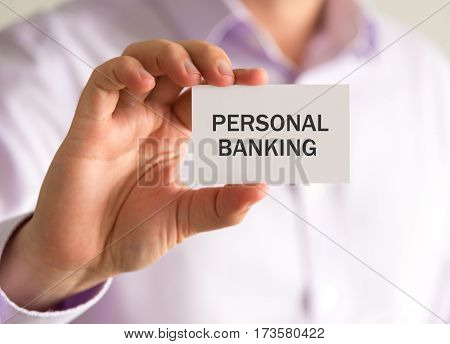 Businessman Holding A Card With Personal Banking Message