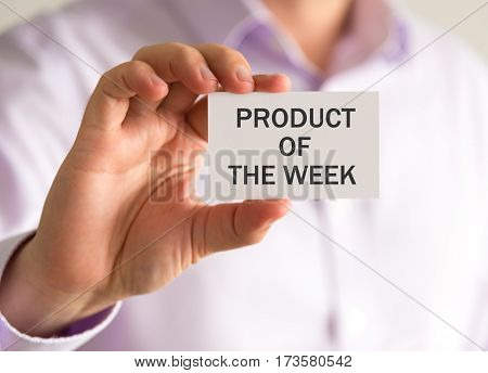 Businessman Holding A Card With Product Of The Week Message