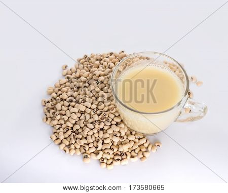 Soy Milk Cup And Soy Bean On White Background View From Above.