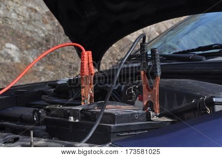 Cables for switching the battery on the car, recharging battery on the road. Start engine.
