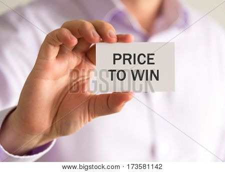 Businessman Holding A Card With Price To Win Message