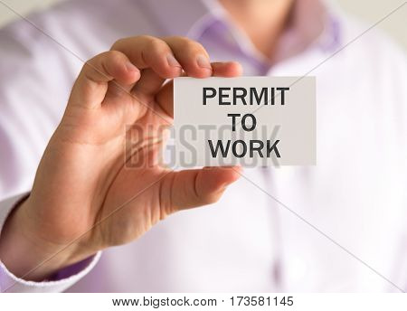 Businessman Holding A Card With Permit To Work Message