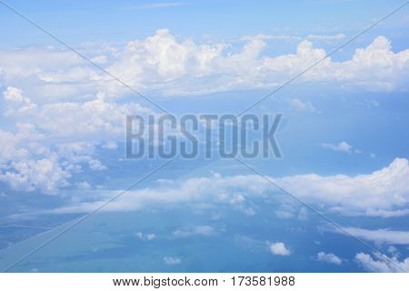 Abstract background of beautiful blue sky with clouds over sea and land