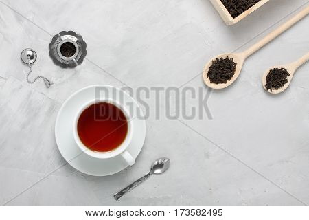 Cup Of Tea Silver Wooden Spoons Teapot On Concrete Background.
