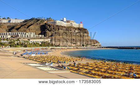 View on the beach Playa de Puerto Rico on the Canary Island Gran Canaria Spain - 13.02.2017.