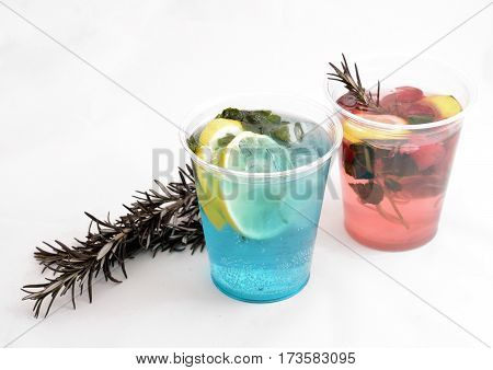 two fresh drink with lemon, mint and rosemary on a white background