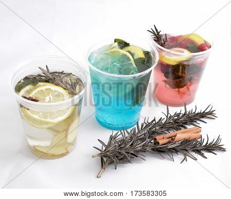 Three types of detox water with fruit in glasses isolated on a white background, healthy drink abstract