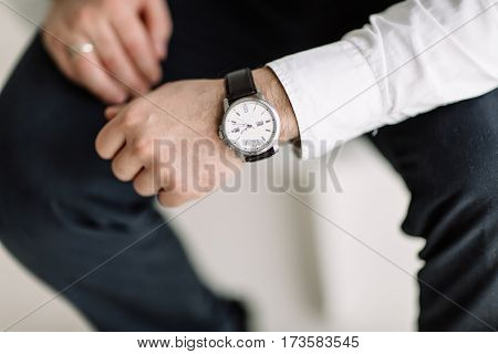 Watch With White Dial On The Hand