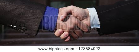 Business panorama. Business firm handshake. Business agreement. Handshake on background bank. Shake hands with each other. Business friendship partners. Business concept
