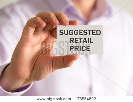 Businessman Holding A Card With Suggested Retail Price Message