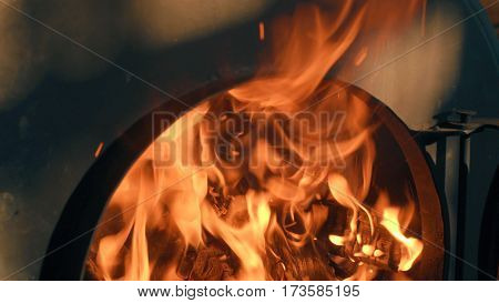 Wood burning in the stove. Fire close up.