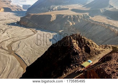 The truck carries cargo in the Himalayas. Top view of the Kali Gandaki gorge. Nepal. Kingdom of Mustang.