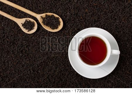 Dry Black Tea Leaves Texture Background Wooden Spoons Cup.