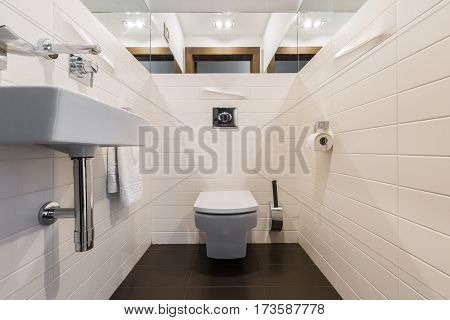 Minimalist Bathroom With Toilet And Sink