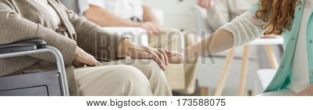 Holding Patient's Hand