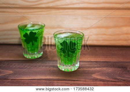 green cocktail on St. Patrick's day on a wooden background