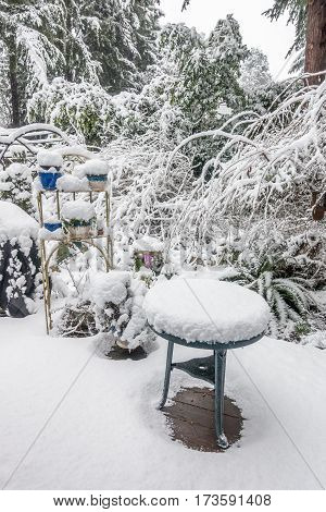 A porch is covered in white fluffy snow after a storm.