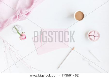 Feminine workspace with notebook cup of coffee paper blank pink flower pencil. Business concept. Flat lay top view poster