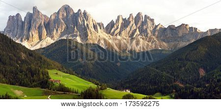 evening panoramic view of Geislergruppe or Gruppo dele Odle Italian Dolomites Alps mountains