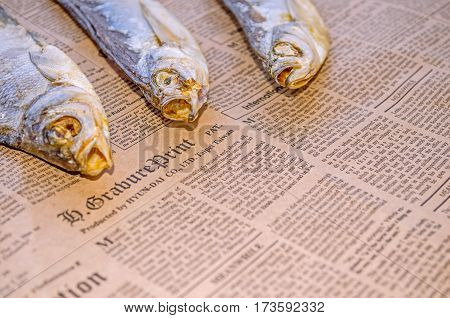 Dried fish with beer on old paper, for bars and restaurants. Russia, Saint-Petersburg 25 February 2017