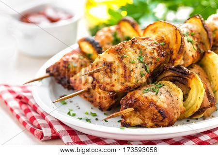 Grilled shish kebab or shashlik on skewers closeup on white background